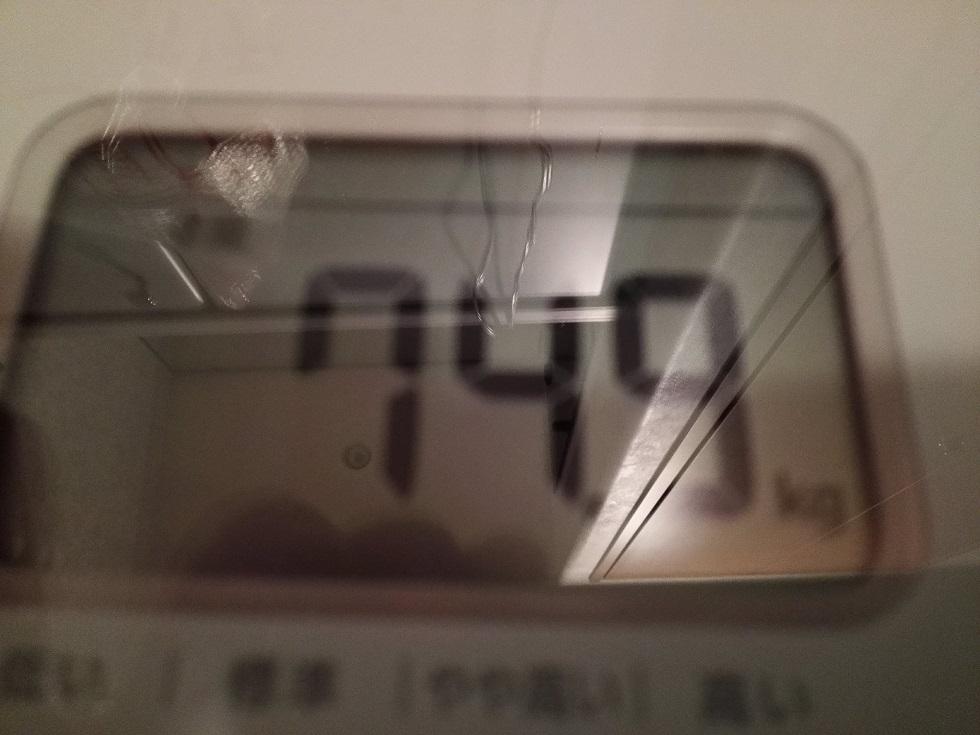 74.9kg